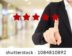 Small photo of Businesswoman hand pointing red five star over blur background, customer excellent rating satisfacation, customer feedback