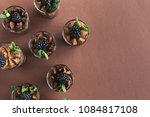 chocolate mousse in glasses ... | Shutterstock . vector #1084817108