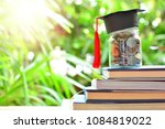coins saving set on books for... | Shutterstock . vector #1084819022