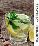 water with fresh lemon and mint ... | Shutterstock . vector #1084819286