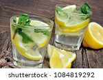 water with fresh lemon and mint ... | Shutterstock . vector #1084819292