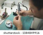 artificial tooth being done by... | Shutterstock . vector #1084849916