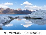 Small photo of Reflection of Pangong Lake in early Spring in Leh Ladakh, North India. Pangong Tso is a beautiful endorheic lake situated in the Himalayas extending from India to China