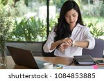 asian businesswoman look at her ... | Shutterstock . vector #1084853885