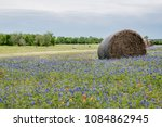 bale of hay in a field of... | Shutterstock . vector #1084862945