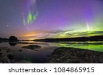 the northern lights over the... | Shutterstock . vector #1084865915