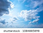 blue sky with clouds and sun... | Shutterstock . vector #1084885898