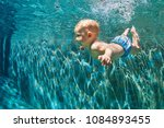 happy child learn to swim  dive ... | Shutterstock . vector #1084893455