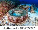 underwater pollution   rubber... | Shutterstock . vector #1084897922