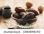 dry dates in a bowl on a... | Shutterstock . vector #1084898192