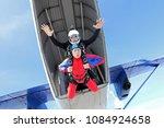 skydiving. summer tandem jump. | Shutterstock . vector #1084924658