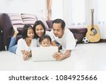 happy asian family and little... | Shutterstock . vector #1084925666