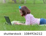 girl child with laptop outdoors ... | Shutterstock . vector #1084926212