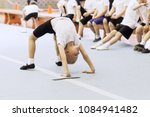 little flexible boy showing... | Shutterstock . vector #1084941482