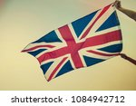 waving uk flag in the blue sky  ... | Shutterstock . vector #1084942712