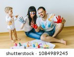 happy family son with parents... | Shutterstock . vector #1084989245