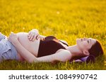 young pregnant woman holding... | Shutterstock . vector #1084990742