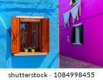walls painted in vivid colors... | Shutterstock . vector #1084998455