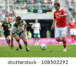 Small photo of WROCLAW, POLAND - JULY 21: Semifinal Polish Masters tournament between Slask Wroclaw and Benfica Lisbon, Marcin Kowalczyk (L) and Bruno Cesar Zanaki (R) in action on July 21, 2012 in Wroclaw, Poland.