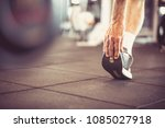 senior man stretching and... | Shutterstock . vector #1085027918