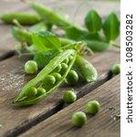Fresh sweet pea in pod, selective focus - stock photo