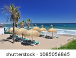 beach in the popular resort of... | Shutterstock . vector #1085056865