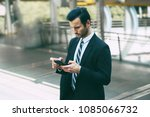 a handsome young businessman... | Shutterstock . vector #1085066732