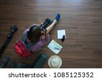 overhead view of traveler woman ... | Shutterstock . vector #1085125352