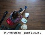 overhead view of traveler woman ... | Shutterstock . vector #1085125352