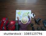 overhead view of traveler woman ... | Shutterstock . vector #1085125796