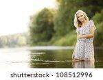 beautiful girl in water - stock photo