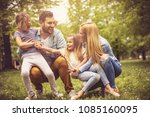 happy young family playing... | Shutterstock . vector #1085160095