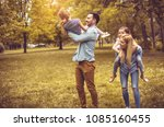 happy young family playing... | Shutterstock . vector #1085160455