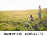 children playing with the dog... | Shutterstock . vector #1085161778