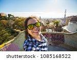 young happy woman making selfie ... | Shutterstock . vector #1085168522