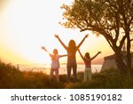 silhouette of mother with two... | Shutterstock . vector #1085190182