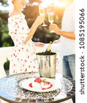 happy couple with glasses of... | Shutterstock . vector #1085195066