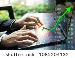 investing with laptop online. ... | Shutterstock . vector #1085204132