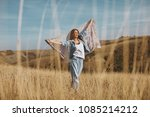 young woman holding a scarf in... | Shutterstock . vector #1085214212