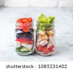 greek salad and caesar salad in ... | Shutterstock . vector #1085231402