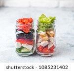 greek salad and caesar salad in ... | Shutterstock . vector #1085231402