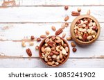 mixed nuts in wooden bowl and... | Shutterstock . vector #1085241902