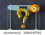 on the scales is measuring tape ... | Shutterstock . vector #1085250782