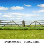 Old Wooden Fence And Green...
