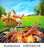 grilled sausages on grill und... | Shutterstock . vector #1085266118