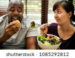 couple having fast food on the... | Shutterstock . vector #1085292812