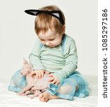 smiling baby girl with kitten... | Shutterstock . vector #1085297186
