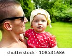 father play's with his baby girl   Shutterstock . vector #108531686