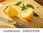 sharp knife blade and cut lemon ... | Shutterstock . vector #1085319206