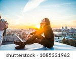 young woman sit on house roof... | Shutterstock . vector #1085331962